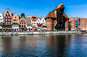 Picturesque Scenery In The Old Town Of Gdansk In Poland With Motlawa River And The Crane At The Far