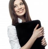 closeup portrait of attractive  caucasian smiling woman brunette isolated on white studio shot lips toothy smile face hair head and shoulders document case businesswoman