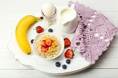 Delicious breakfast with oatmeal and milk