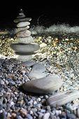 Pyramid From Pebble On Stony Seacoast At Night