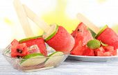 Watermelon ice-cream on table on bright background