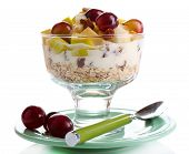 Healthy breakfast - yogurt with  fresh grape and apple slices and muesli served in glass bowl, isola
