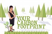 The word your carbon footprint and thoughtful businesswoman against forest with trees