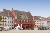 FREIBURG IM BREISGAU, GERMANY - AUGUST 6, 2014: Historical Merchant Hall in Freiburg, a city in the south-western part of Germany in the Baden-Wurttemberg state.