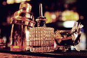 Bartender tools on bar counter, warm light, retro style photo