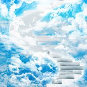 Spiral stairs in sky with clouds and sun