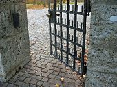 The Last Way, Entrance To Cemetery Ground, Opened Iron Door And Cobble Stone Pavement