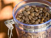 Appetizing Coffee Beans In Glass Container.