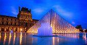 PARIS, FRANCE - June 26:  Louvre Pyramid on a rainy night in Paris, June 26, 2014.