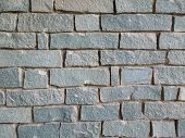 Background of grey stone wall texture