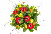 a colorful bouquet of spring flowers on a white background.