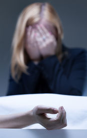 stock photo of life after death  - Young woman suffering after death of close relative - JPG