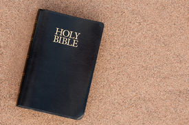stock photo of holy  - Vertical view of Holy Bible on sand - JPG