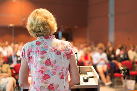 picture of professor  - Female academic professor lecturing at Conference. Audience at the lecture hall. ** Note: Soft Focus at 100%, best at smaller sizes - JPG