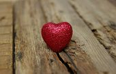 image of heartfelt  - Red heart on a wood background  - JPG