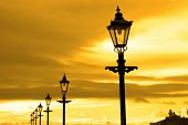 Row Of Vintage Lamps At Sunset