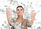 stock photo of lottery winners  - Young business woman and money banknotes flying in air on the white background - JPG