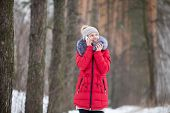 Happy Smiling Female In Red Winter Jacket Talks On Mobile Phone, Outdoors In Park