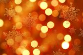 Orange Christmas background blur and snowflakes