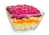 Russian herring salad in glass bowl isolated on white