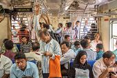 MUMBAI, INDIA - DECEMBER 12, 2012: Unidentified passengers inside Indian Railway local train on December 12, 2012 in Mumbai, India. Indian Railways carries about 7,500 million passengers annually.