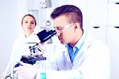 Young researcher carrying out scientific research in lab