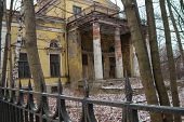 old dilapidated building with a fence