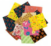 Variety of colorful quilting squares on a white background