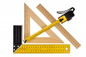 foto of measurements  - Metallic tool to measure right angle triangle and wooden ruler pencil and tape measure on a white background - JPG