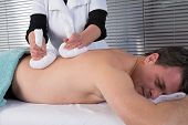 Man Getting Thai Massage In The Beauty Salon