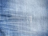 image of indigo  - Texture of threadbare denim of indigo color - JPG