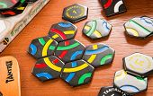 RUSSIA-JULY 7, 2013: Logic game Tantrix.Tantrix is a hexagonal tile-based abstract game invented by Mike McManaway from New Zealand. Each of the 56 different tiles in the set contains three lines.