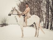 picture of beast-man  - Wild man on horseback at winter day - JPG