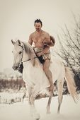 image of beast-man  - Wild man on horseback at winter day - JPG