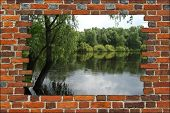 Broken Brick Wall With View To The Summer River