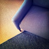 Blue Textile Armchair And Knitted Carpet