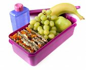 stock photo of lunch box  - Healthy lunch in a bright pink lunch box - JPG