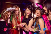 stock photo of ladies night  - Pretty friends on a hen night at the nightclub - JPG
