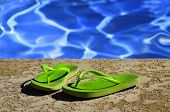 Detail of flip flops sandals by swimming pool