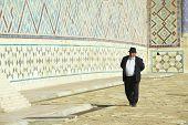 Man explores mausoleum of Khoja Ahmed Yasavi in Turkistan, Kazakhstan.