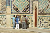 People explore mausoleum of Khoja Ahmed Yasavi in Turkistan, Kazakhstan.