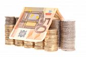 Fifty euro banknote and coins organized in columns isolated on white background