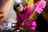 image of rapper  - Cool African American male DJ playing music at a party - JPG