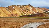 Gorgeous orange and pink mountains. Reserve Landmannalaugar, Iceland. The route starts on a stream