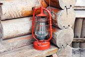 Kerosene lamp on wooden hose background
