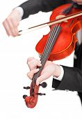 Vertical shot of a violinist playing a violin isolated on white background with the focus on his fingers