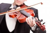 Studio shot of a violinist playing a violin isolated on white background with the focus on his fingers