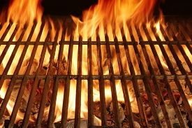 stock photo of braai  - Burning Hot Fire in a Barbecue with an Empty Grill - JPG