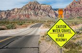 stock photo of flashing  - A sign in southern Nevada warns of a flash flood area ahead - JPG