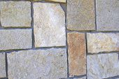 stock photo of mortar-joint  - Angled close up of a modern stone wall - JPG
